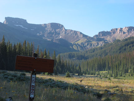 West Fork trailhead sign with Coxcomb Pass and Coxcomb Peak in background