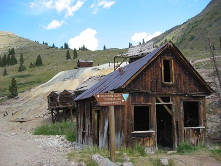 Engineer Pass road sign and old mine in Animas Forks