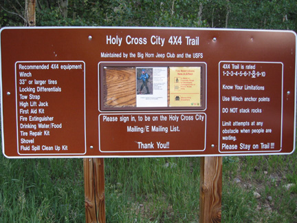 Sign for road to Holy Cross City